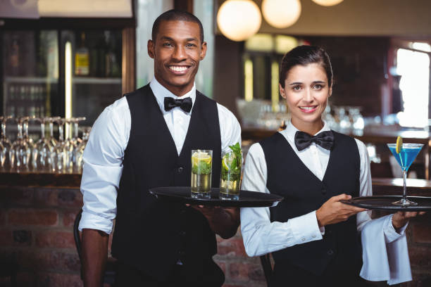 Most popular jobs Nigerians do abroad: waiters with cocktail trays